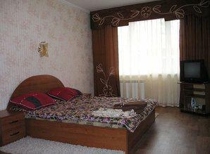 In the apartment: Room: large double bed, two armchairs, cof