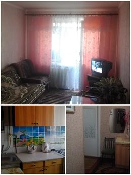 The apartment is located in the city center, close to home p